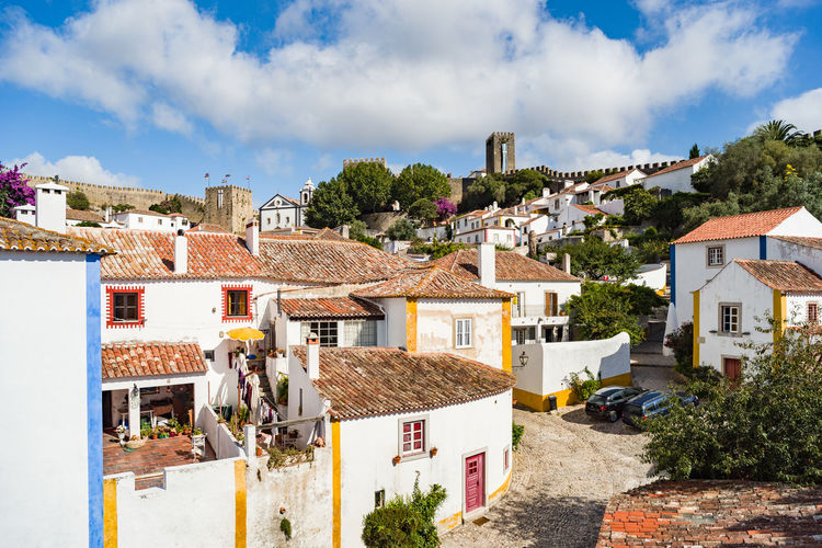 Fortified medieval village of Obidos, Portugal Battlements Castle Castle View  Castle Walls Europe Fort Fortress Fortress In Europe Fortress Wall Houses Hystorical Obidos Portugal Portugal Red Roofs Red Tiles Towers Towers And Sky Village Village View Walls Óbidos