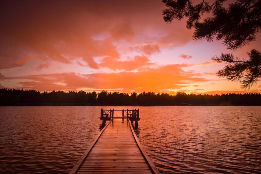 Water Pier Lake Sunset Tranquil Scene Scenics Tranquility Sky Orange Color Silhouette Idyllic Calm Cloud Jetty Dramatic Sky Beauty In Nature Nature Majestic Long EyeEm Masterclass Outdoors Beautiful Light And Shadow beauty