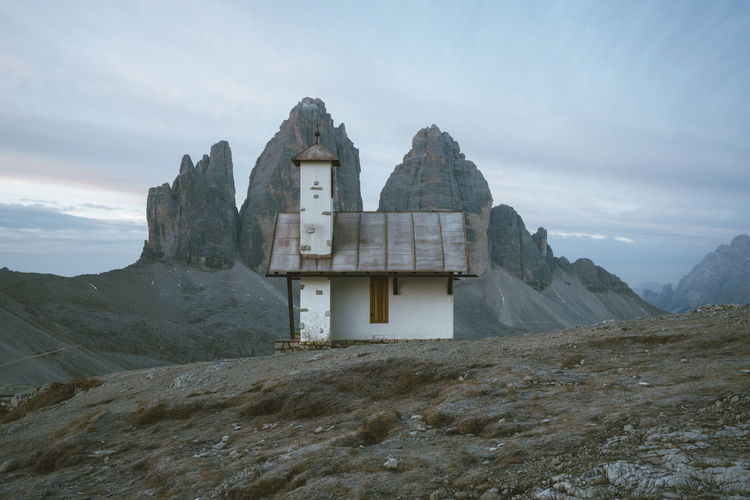Lonely chapels of the Alps Check out my prints at http://simonmigaj.com/shop/ and visit my IG http://www.instagram.com/simonmigaj for more inspirational photography from around the world. Sky Mountain Architecture Built Structure Cloud - Sky Nature Building History The Past Beauty In Nature No People Building Exterior Day Belief Religion Scenics - Nature Mountain Range Outdoors Environment Tranquility Ancient Civilization Chapel Tre Cime Di Lavaredo Tre Cime Dolomites