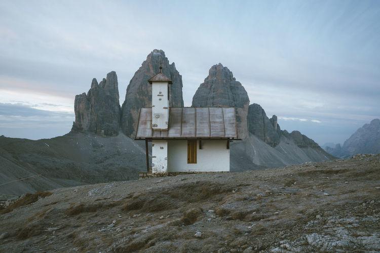Cottage On Mountain Peak Against Sky