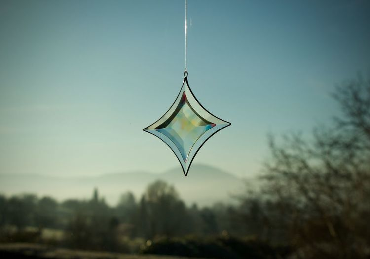 Close-up of pendant against clear sky