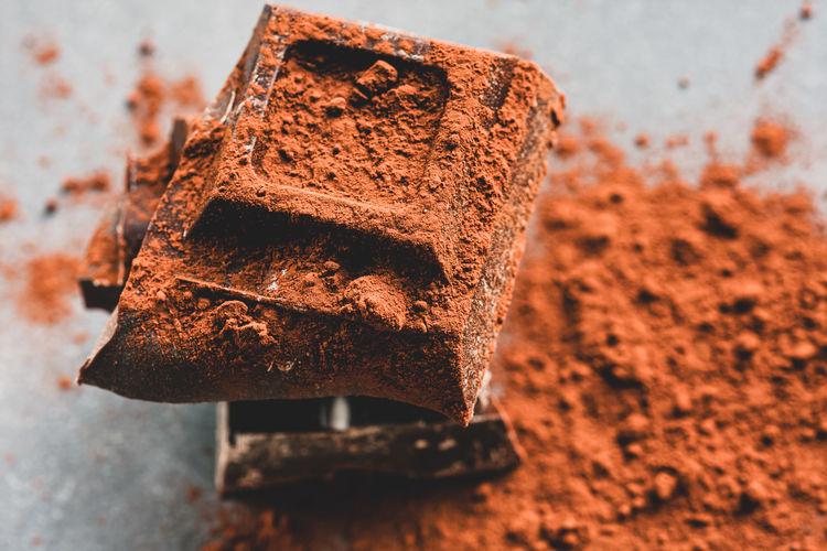 Close-up of chocolate cake on rusty metal