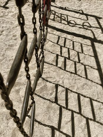 Sunlight Shadow Chain Metal Day Sunny High Angle View Outdoors Hanging No People Strength Close-up Playground Ladder Sand Pattern Lines Fine Art Photography Sunlight Sandpoint Miksang Patterns Shadows & Lights Idaho IPhoneography