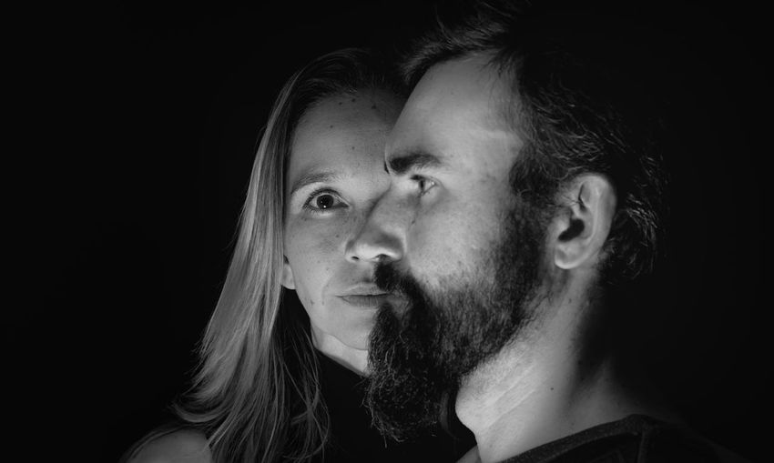 Portrait of man and woman on black background