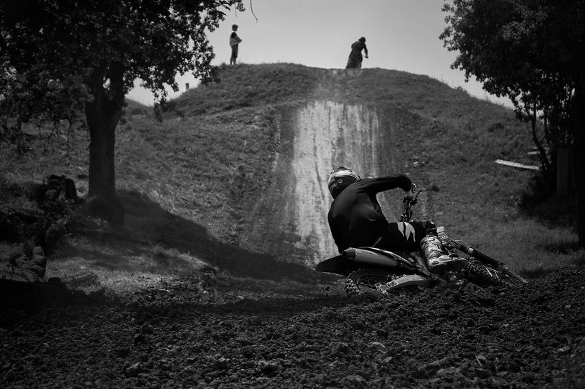 Motocross cornering hard Activity Blackandwhite Casual Clothing Extreme Sports Leisure Activity Lifestyles Men Mode Of Transportation Motocross Nature One Person Outdoors Real People Riding Transportation