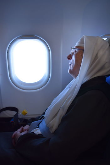 Nun traveling by plane