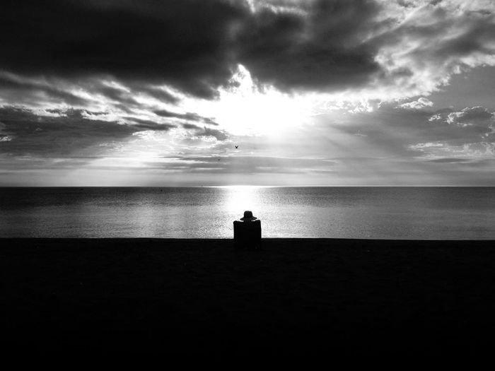 Solitude SPAIN Andalusia Black & White Black And White Sea Sky Water Cloud - Sky Horizon Over Water Horizon Silhouette Beauty In Nature Tranquil Scene Tranquility Beach Nature Land One Person Real People Sitting Leisure Activity Outdoors