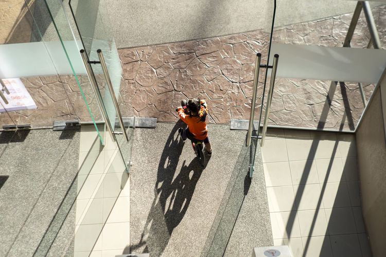 High angle view of man and bicycle on building
