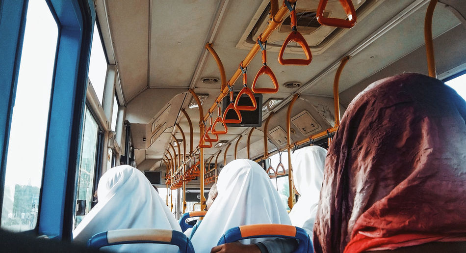Muslim School Girls In A Bus From School Vehicle Interior Real People Public Transportation Mode Of Transportation People Transportation Indoors  Bus Sitting Men Women Day Rear View Adult Window Lifestyles Train Incidental People
