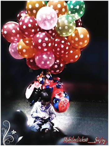 Baloonseller's boy.... Will he ever get one to play. Baloon Seller