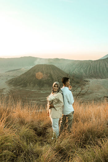 Men Adult Togetherness Mountain Nature Women Males  Landscape Two People Beauty In Nature Leisure Activity Plant People Females Full Length Environment Couple - Relationship Sky Mid Adult Scenics - Nature