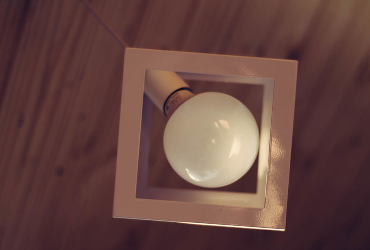 Indoors  No People Close-up Directly Above Illuminated Wood - Material Shape Lighting Equipment High Angle View Table Geometric Shape White Color Still Life Container Light Box Design Box - Container Light - Natural Phenomenon Frame Electric Lamp Precious Gem