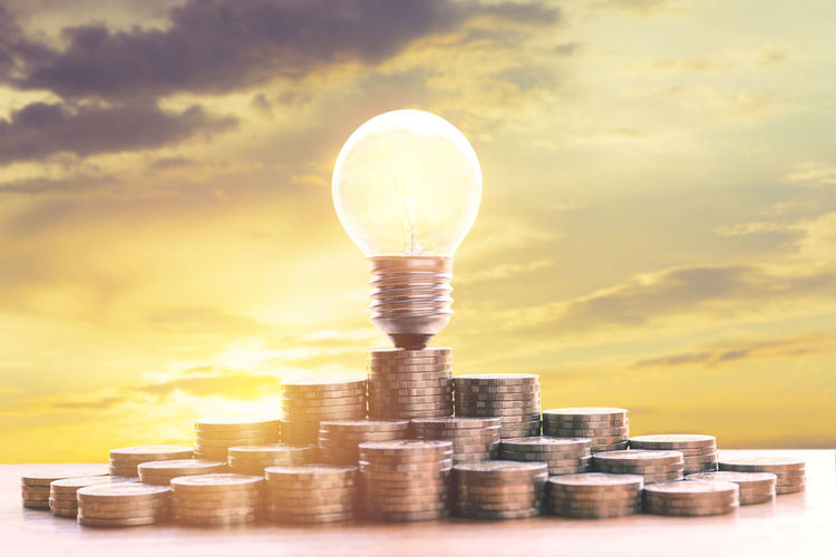 Business Cloud - Sky Coin Currency Digital Composite Economy Finance Fuel And Power Generation Growth Illuminated Investment Journey Large Group Of Objects Light Bulb Lighting Equipment Nature No People Savings Sky Stack Wealth
