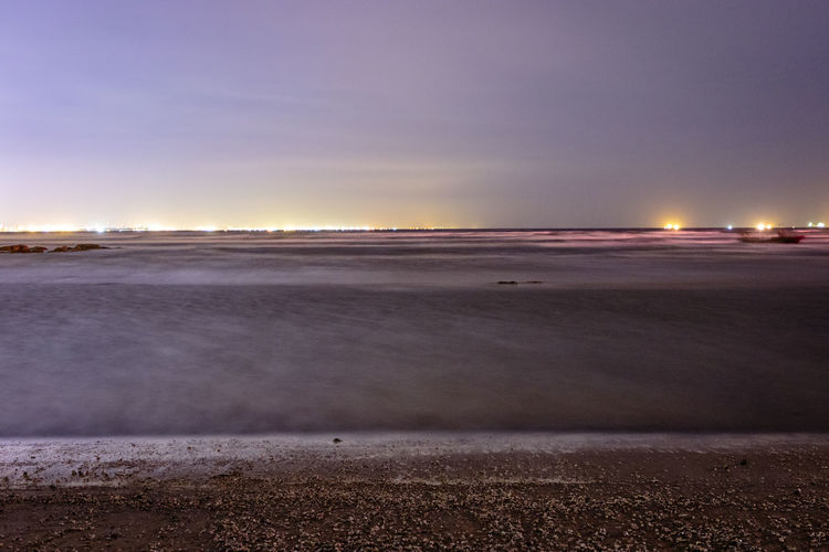 Beach Beauty In Nature Evening Illuminated Landscape Long Exposure Nature Night No People Outdoors Salt - Mineral Scenics Sea Shore Shoreline Sky Snow Sunset Tranquil Scene Tranquility