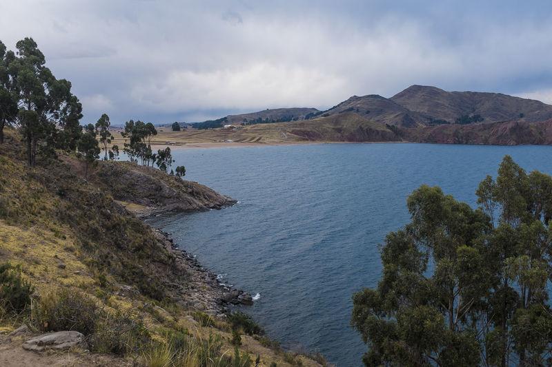 Beauty In Nature Capachica Cloud Cloud - Sky Cloudy Coastline Idyllic Lake Landscape Mountain Mountain Range Nature Non-urban Scene Outdoors Peru Puno Remote Scenics Sky Titicaca Tranquil Scene Tranquility Water