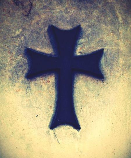 A cross on an ancient gravestone. Cemetery Gothic Gravestone Eternal Peace