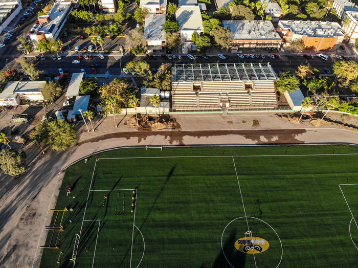 High angle view of soccer field against buildings