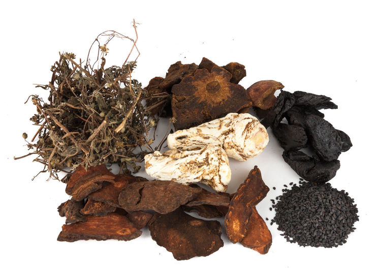 A group of popular Chinese Herbs for general well being Angelica Sinensis Root He Shou Wu Healthcare Polygonum Multiflorum Shu Di Huang Traditional Chinese Medicine Black Sesame Close-up Dang Gui Food Freshness Herbal Medicine No People Pomegranate Studio Shot White Background