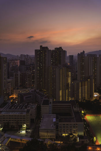 High angle view of illuminated buildings against sky during sunset