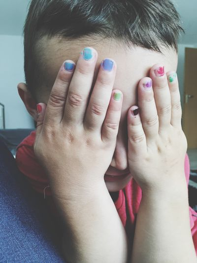 Child Children Boy Youngboy Kids Being Kids Kids Playing Kids Photography Kidsnails Childrennails Indoors  Colorful Colours Handsontheface Person Focus On Foreground Front View Hand Nails Nailswag Boystyle Babyboy Childhood Children Photography Children Of The World