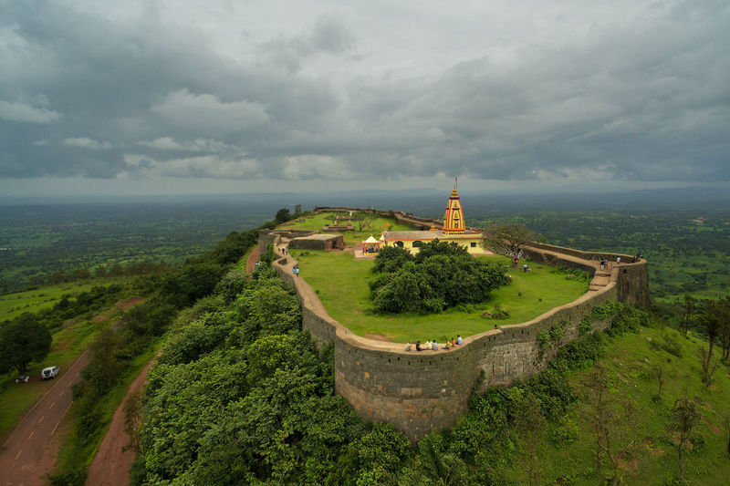 An aerial view of the Rajhans Gad fort in Yellur, Karnataka. India Aerial Aerial View Architecture Beauty In Nature Building Exterior Built Structure Cloud - Sky Day Dji Fort Fortress Wall Forts Of India High Angle View History Landscape Nature Old Ruin Outdoors Place Of Worship Scenics Sky Spirituality Travel Destinations Tree