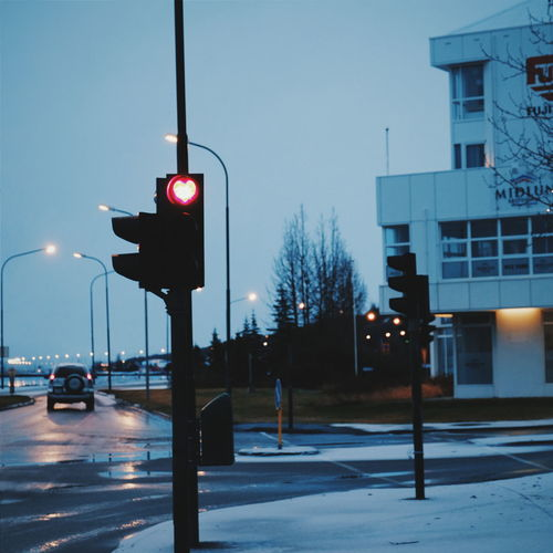 Love in the road. Iceland Akureyri Love Heart Winter Traveling Traffic Traffic Lights Red Snow Road Stop Pause Europe Morning