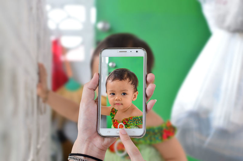 Capture Childhood Child Real People One Person Holding Portrait Males  Innocence Technology Cute Indoors  Front View Men Casual Clothing Boys Lifestyles Focus On Foreground Mobile Phone Wireless Technology
