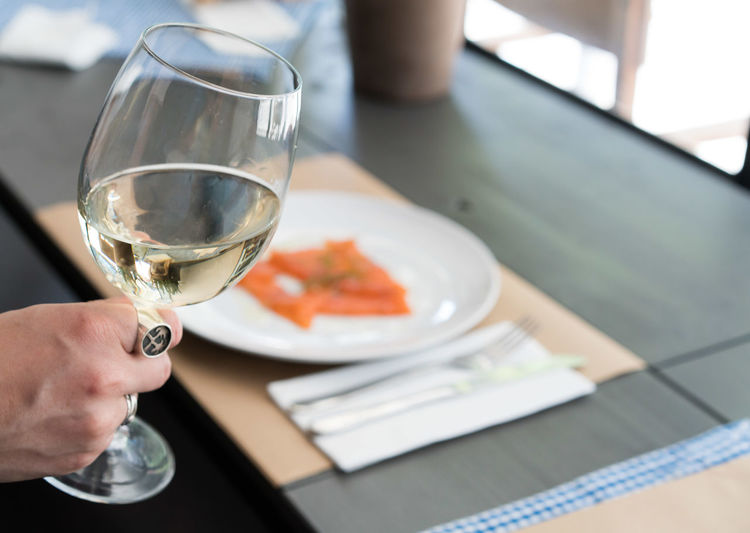 Close-up of hand holding a glass of wine