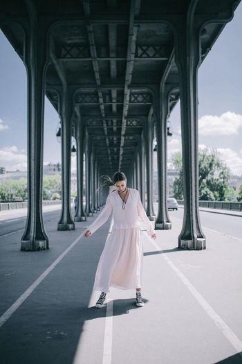 Bridge in Paris Full Length One Person Standing Bridge Architecture Women Fashion Bridge - Man Made Structure Clothing Woman Girl Paris Dress Soft Pink Softness Dreamy Lifestyle Beautiful France Symmetry Lines Street Hair Wind Sky