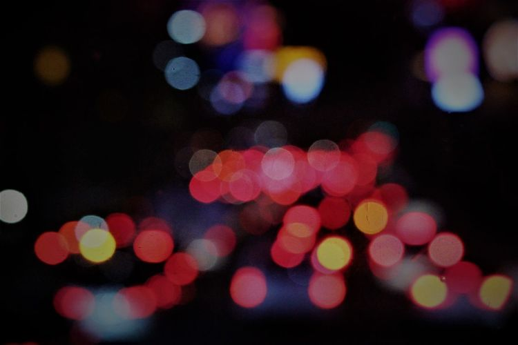 Abstract Backgrounds Black Background Bokeh Photography Christmas Decoration City Decoration Defocused Disco Lights Exploding Illuminated Light Effect Multi Colored Neon Night Nightlife Outdoors Pattern Polka Dot Spotted Street Light