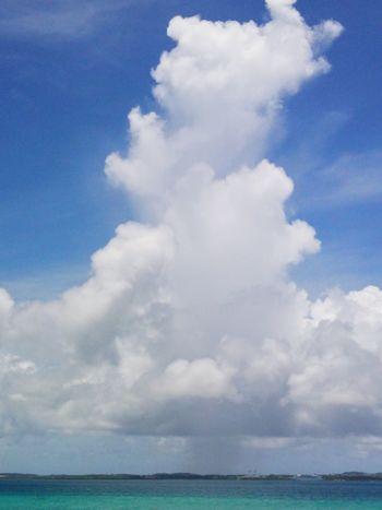 Cumulonimbus Beauty In Nature Blue Cloud Cloud - Sky Cloudscape Day Idyllic Nature Rain Cloud Rain Clouds Rain Or Shine Scenics Sea Seascape Shine And Rain Sky Squall Tranquil Scene Waterfront