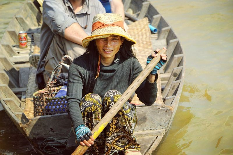 One way of earning money for the inhabitants of the floating villages is to take tourists through the flooded Forrest. Tonlé Sap Lake, Cambodia Tonlesap Cambodia Cambodians Human Interest People People Photography Showcase: February Traveling Rural Scenes Eye4photography  Daily Life Travel Photography Check This Out Boatpeople Portrait Of A Woman Portrait Woman Beauty Girl People Of The Oceans