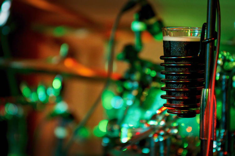 Close-up of beer glass on stand