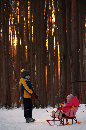 People in forest during winter