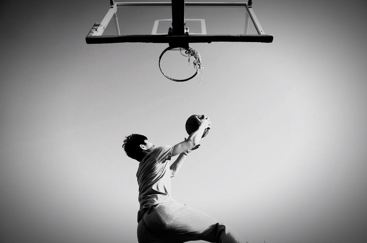 Dunk Basketball - Sport Sport Low Angle View Motion Taking A Shot - Sport Basketball Hoop Copy Space Scoring Playing Men Ball One Person Activity Competitive Sport Basketball Player Making A Basket Skill  Day Outdoors Leisure Games Jordan NBA Lebron James The Street Photographer EyeEmNewHere The Street Photographer - 2017 EyeEm Awards