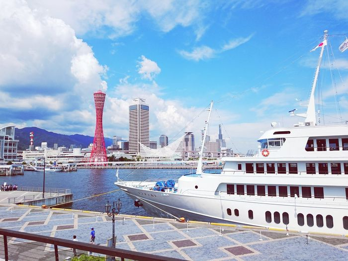 Kobe Port Tower By Bay Of Water Against Sky In City