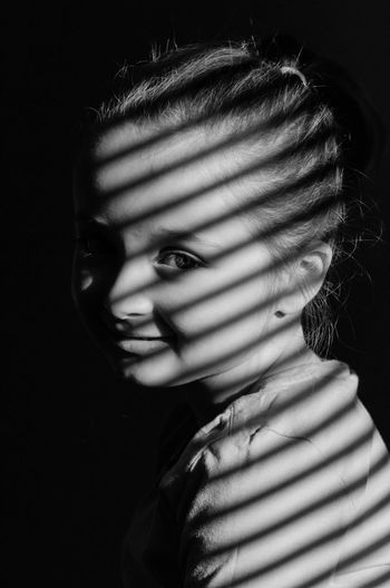 Close-Up Portrait Of Girl In Darkroom