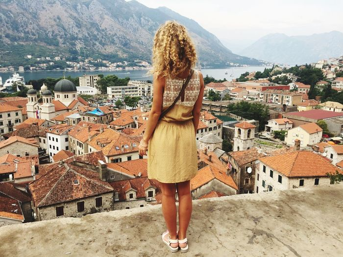 Architecture Mountain Standing Town Young Women Roof TOWNSCAPE Travel Destinations Blond Hair Casual Clothing