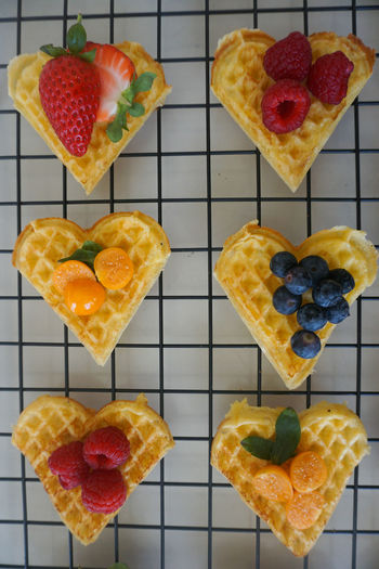 waffle hearts with fresh berries Waffle Fruit Berry Fruit Berry Berries Strawberry Blueberry Raspberry Physalis Fresh Directly Above Backgrounds Dessert Desserts Multi Colored Fruit Red Gelatin Dessert Dessert Sweet Food Close-up Food And Drink Cooling Rack Tart - Dessert Fruitcake Full Frame Repetition Backgrounds Cake Slice Of Cake