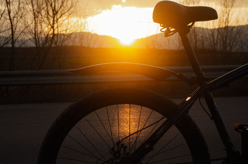 View of bicycle during sunset