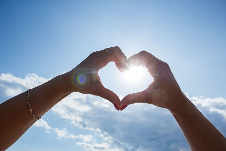 heart with hands Human Hand Hand Human Body Part Sky Sunlight Body Part Lens Flare Sun Finger Real People Low Angle View Human Finger Nature Personal Perspective One Person Lifestyles Sunbeam Day Holding Cloud - Sky Outdoors Positive Emotion Human Limb Bright