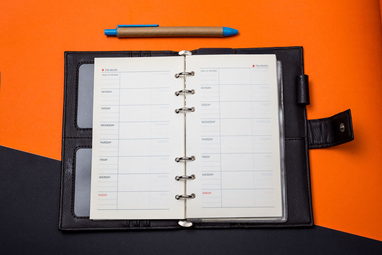 No People Still Life Indoors  Paper Pen Orange Color Note Pad Office Education Communication Calendar Studio Shot Page Personal Organizer Diary Spiral Notebook Table Office Supply Book Personal Accessory