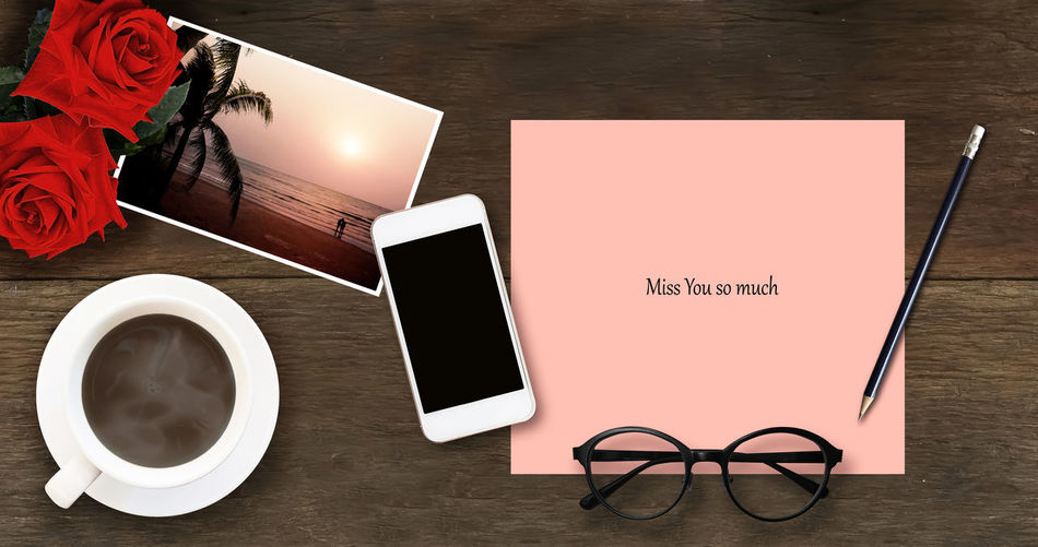 Close-up Coffee - Drink Coffee Cup Diary Drink Eyeglasses  Freshness High Angle View Indoors  Loneliness And Sadness No People Rose - Flower Table Text Wooden Texture Background