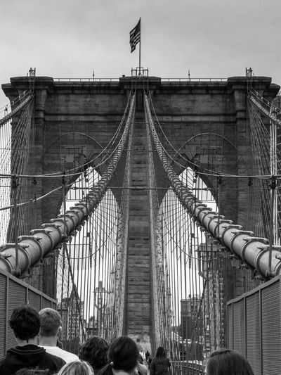 Architecture Built Structure Flag Bridge Bridge - Man Made Structure Connection Sky Suspension Bridge Travel Destinations Patriotism Engineering City Group Of People Transportation Tourism Building Exterior Real People Travel Outdoors Independence Brooklyn Brooklyn Bridge / New York