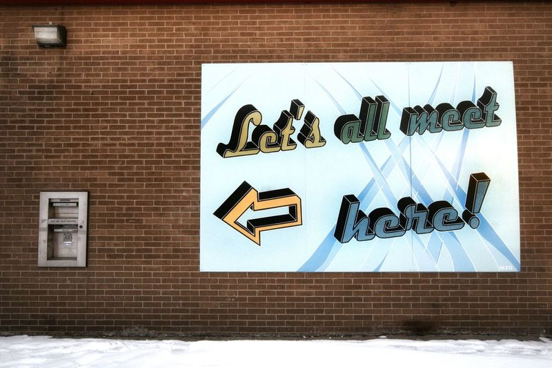 Here's another sign I found funny. It was on the side of a bank. ; ) Outdoors Snow Bank Exterior Brick Wall Architecture Built Structure Street Art Mural Signboard Stories From The City Visual Creativity Adventures In The City The Street Photographer - 2018 EyeEm Awards The Traveler - 2018 EyeEm Awards #urbanana: The Urban Playground