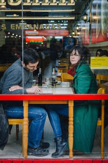 Empanadas Two People Sitting Adult Young Adult Women Young Women Leisure Activity Table Togetherness Cafe Business Real People Casual Clothing Indoors  Friendship Young Men Food And Drink Bonding People Restaurant Couple - Relationship Streetphotography EyeEm Best Shots EyeEm Selects The Art Of Street Photography The Street Photographer - 2019 EyeEm Awards The Traveler - 2019 EyeEm Awards