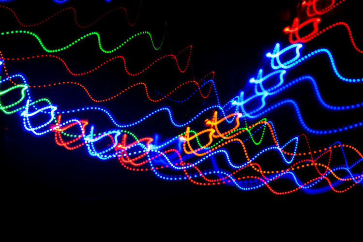 Painting Illuminated Lighting Equipment No People Glowing Light - Natural Phenomenon Motion Night Black Background Studio Shot Abstract Futuristic Technology Pattern Vibrant Color Blue Light Number Light Trail Electricity  Long Exposure Luminosity Light Painting