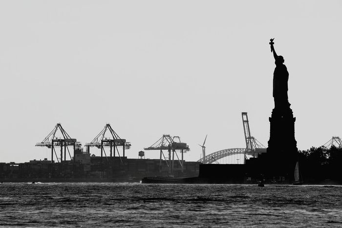 Travel Destinations Travel Water Statue City Outdoors No People Sky Day Sea Urban Skyline Clear Sky Cityscape Tree Manhattan New York City Statureofliberty Welcome To Black The Photojournalist - 2017 EyeEm Awards