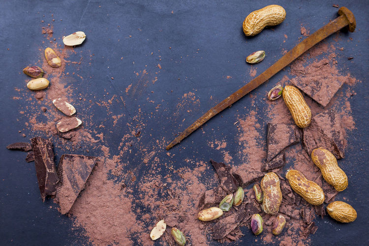 Directly Above Shot Of Chocolates And Nuts By Nail On Table
