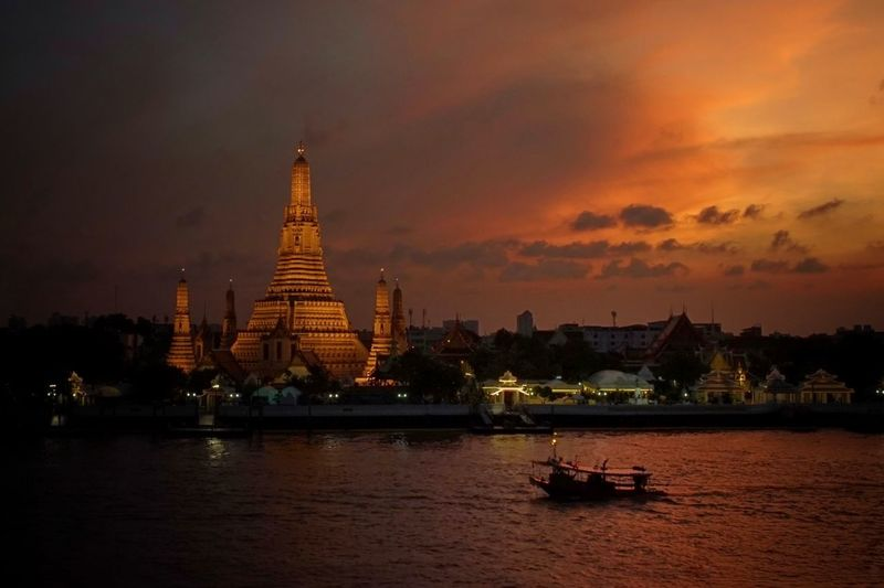 in the evening City Cityscape Sunset Statue Nautical Vessel Beauty Dawn Arts Culture And Entertainment Gold Temple - Building Palace Historic